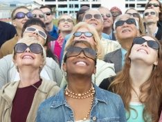 People enjoying their solar eclipse glasses